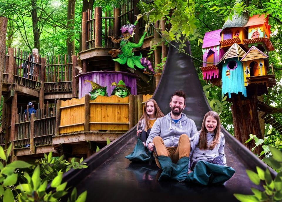Compostie image of a famiy on a slide at BeWILDerwood, as well as a fairy and treehouses.