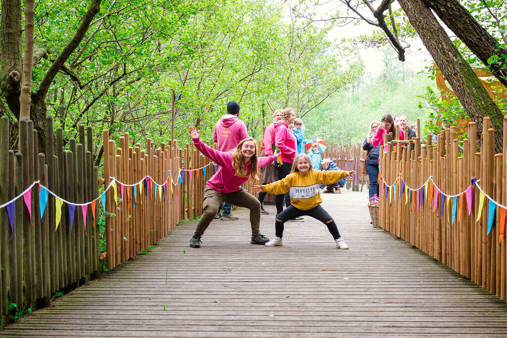 Two kids playing onthe wooden pathway at BeWILDerwood.
