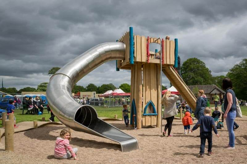 Adventure playground at Astley Hall with a big silver slide and a climbing frame.