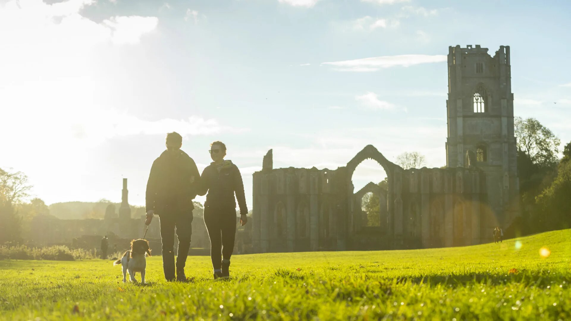 People walking through Fountain's Abbey.