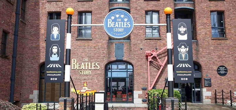 Exterior of The Beatles Story museum in Liverpool with illustrations of the band.