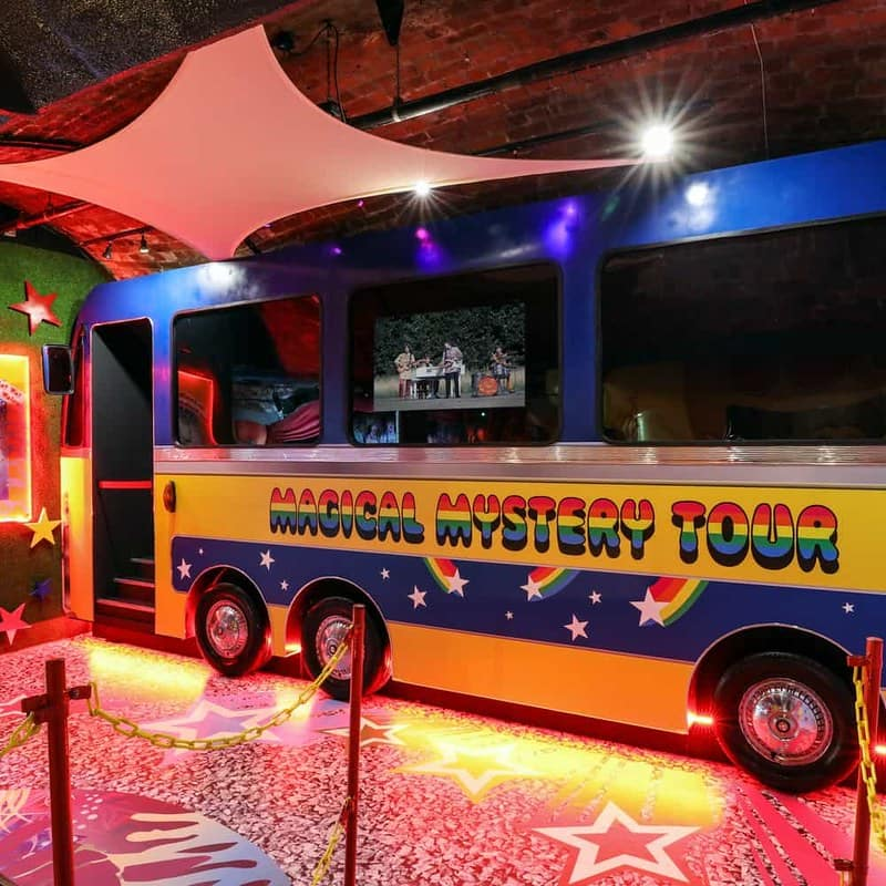 A blue and yellow replica of The Magic Bus at The Beatles Story museum.