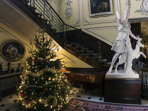 Christmas tree and white statue by the staircase at Hatchlands House.