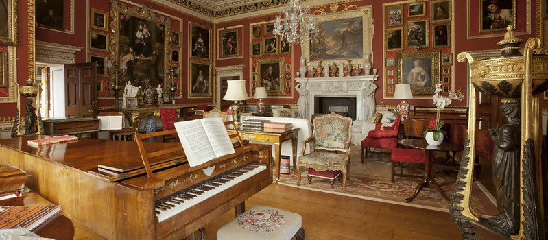 Hatchlands House room with paintings and piano.