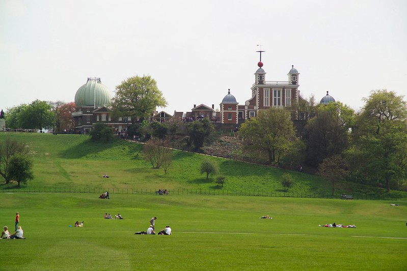 People sitting in Greenwich Park.