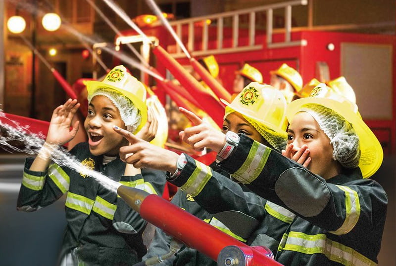 Kids playing as fire fighters at KidZania.
