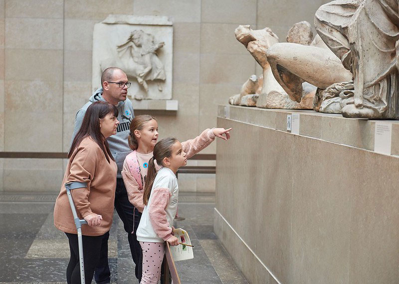 A family admiring an exhibit at the British Museum.