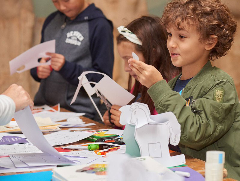 Children taking part in a craft activity at the British Museum.