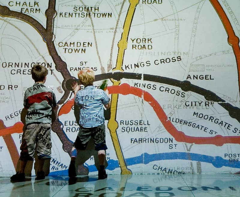 Children exploring a wall of the Underground map.