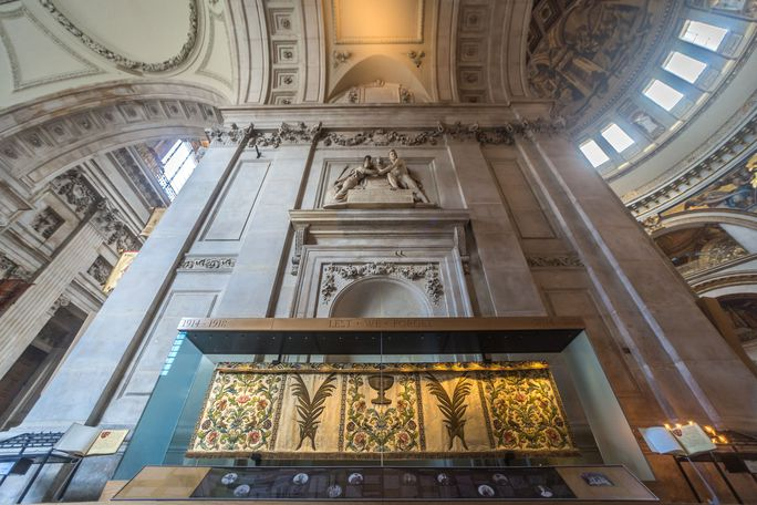 The interior of St Paul's Cathedral, looking up at the ornate ceiling from the Cathedral Floor.