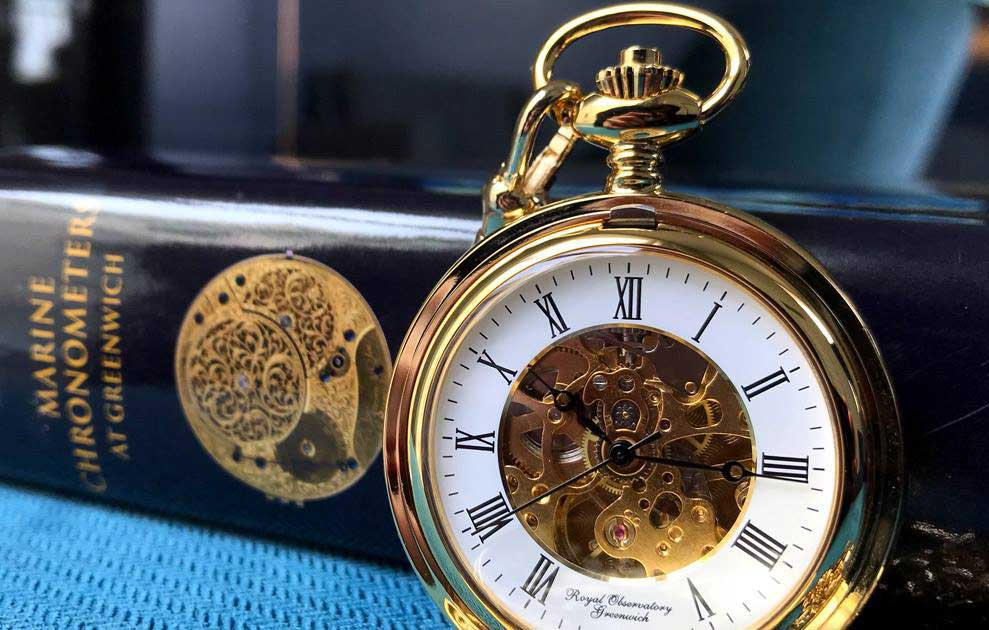 A crafted gold Hunter pocket watch.