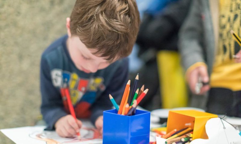 A child enjoying a colouring activity at the Museum of London