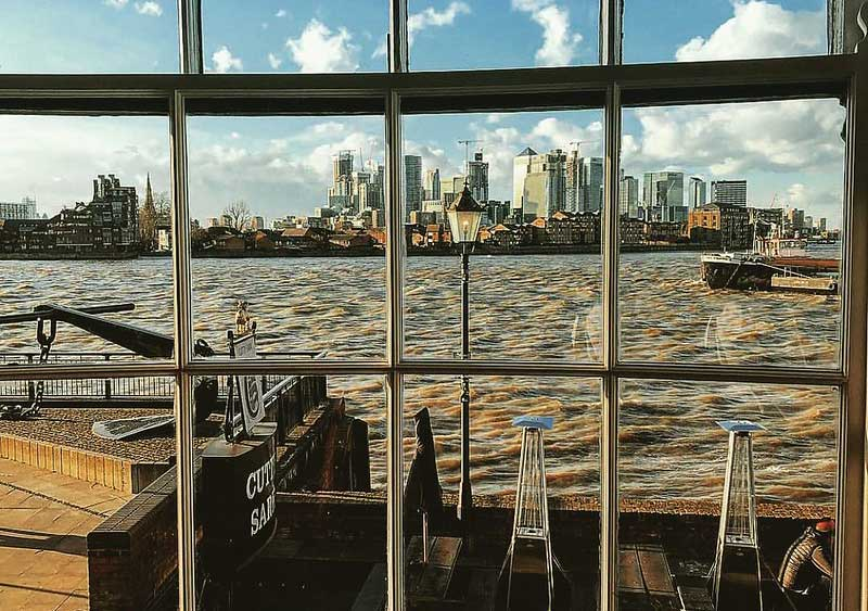 View of Canary Wharf and the River Thames from inside the Cutty Sark.