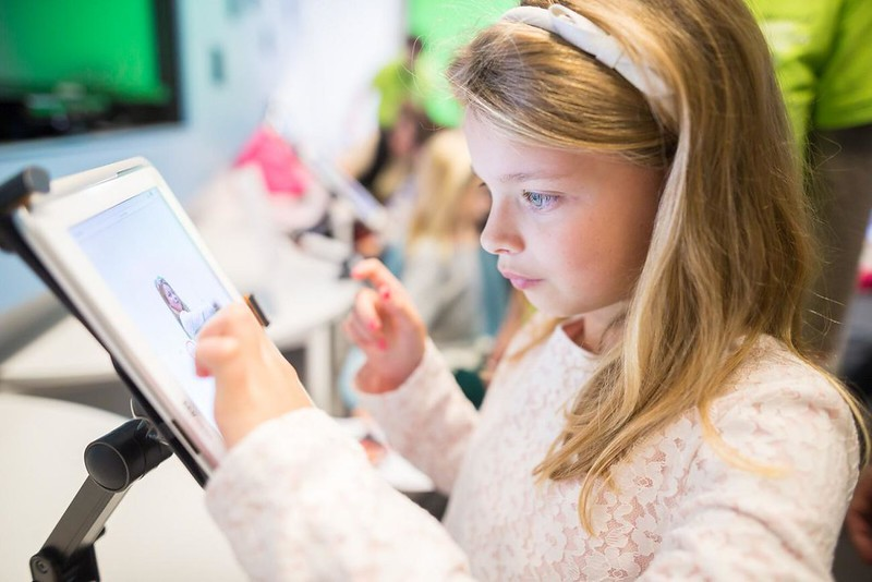 Girl learning with a tablet at the Museum of London.