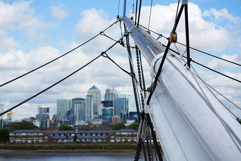 View of London skyline from close-up of the Cutty Sark's helm.