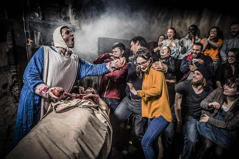 guests at the london dungeon during a live demonstration
