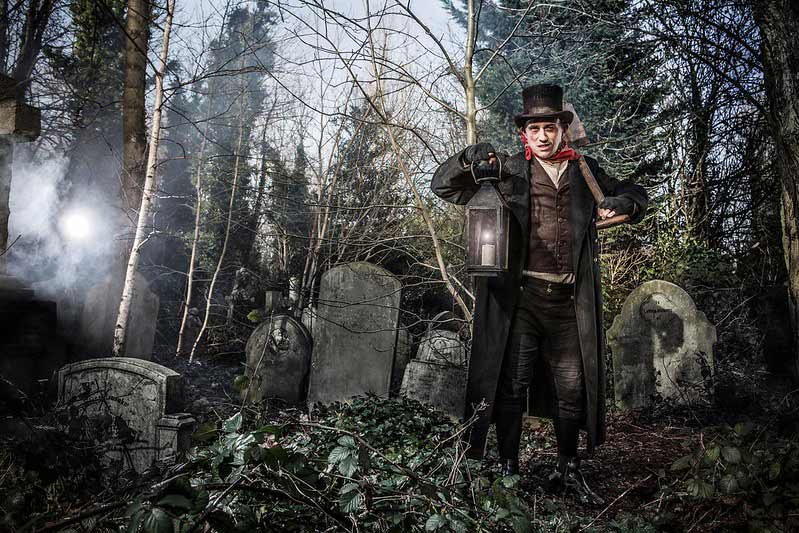 Menacing London Dungeon character in a graveyard with a shovel.