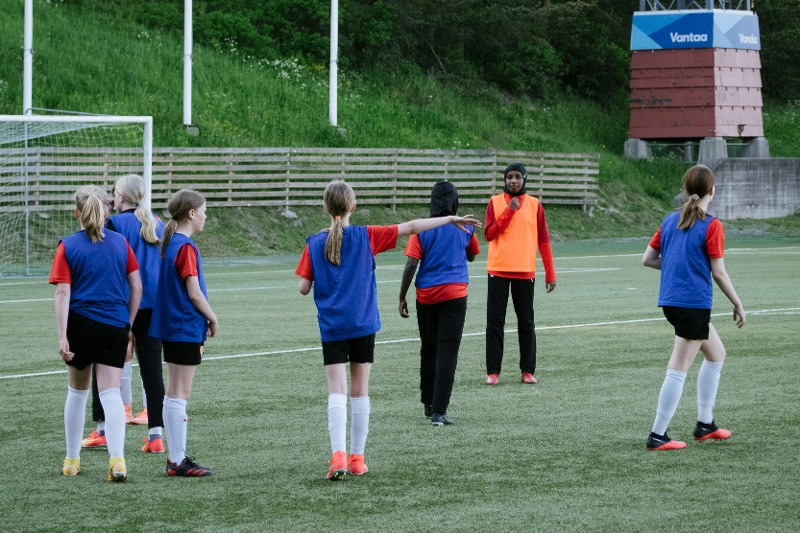 Finnish girls wearing free hijab provided by Football Association of Finland