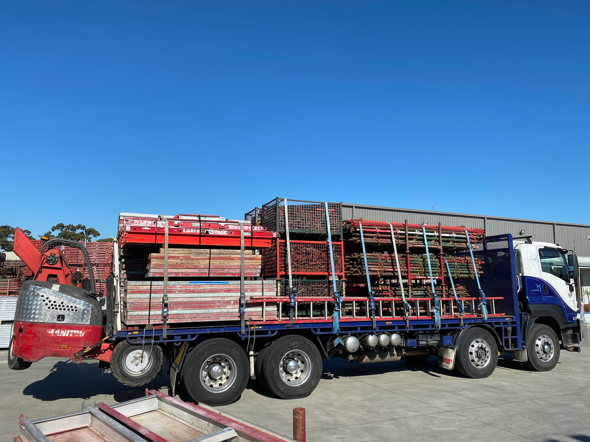 Truck carrying Scaffolding Parts
