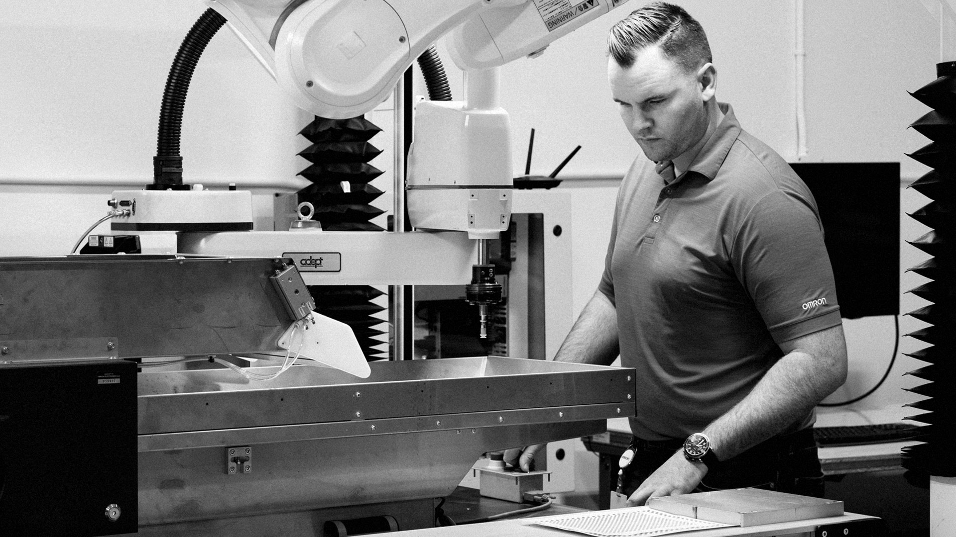 2 men inspecting 3d printing machine