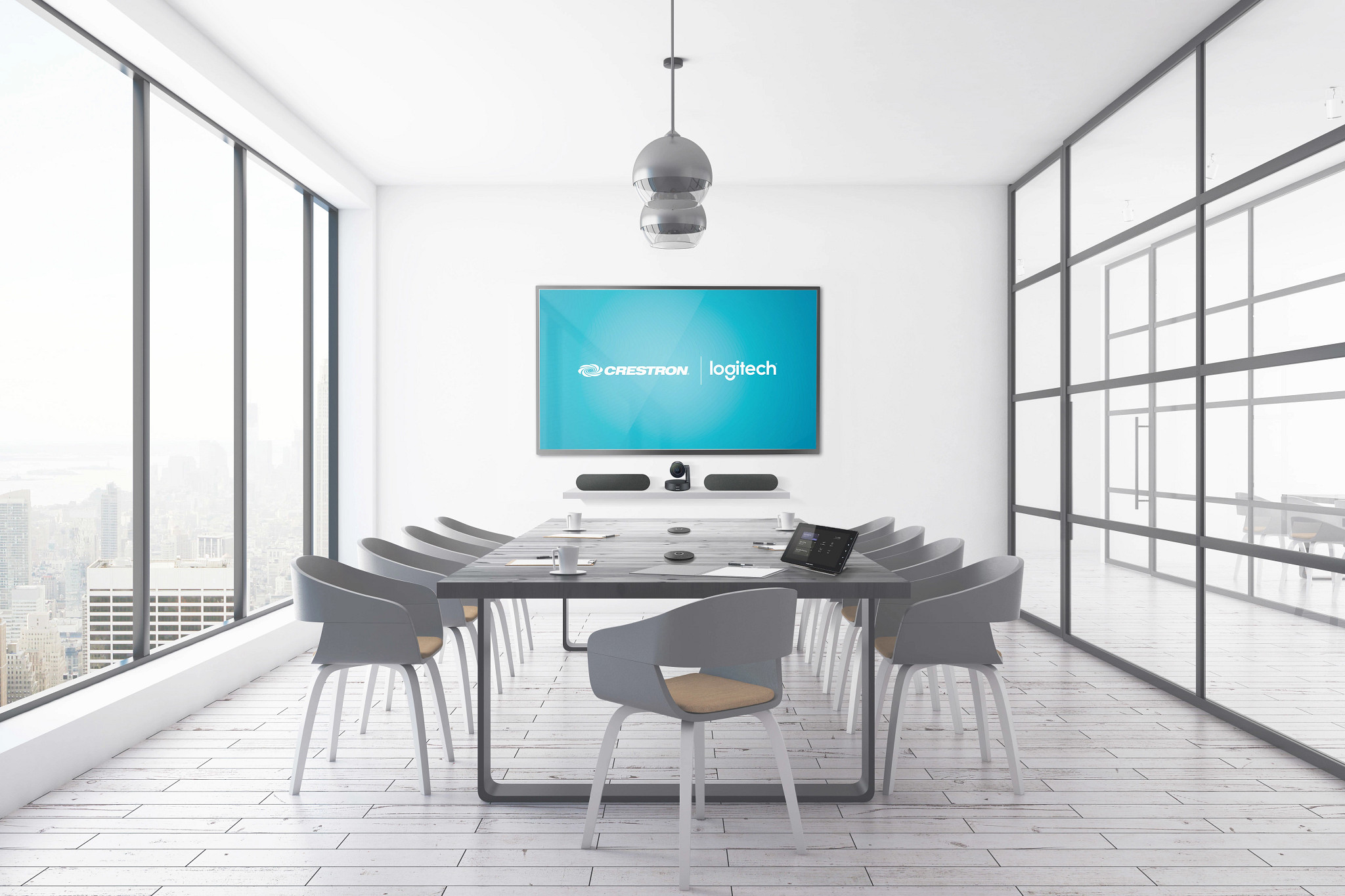 Office meeting room with tv that says Crestron | logitech