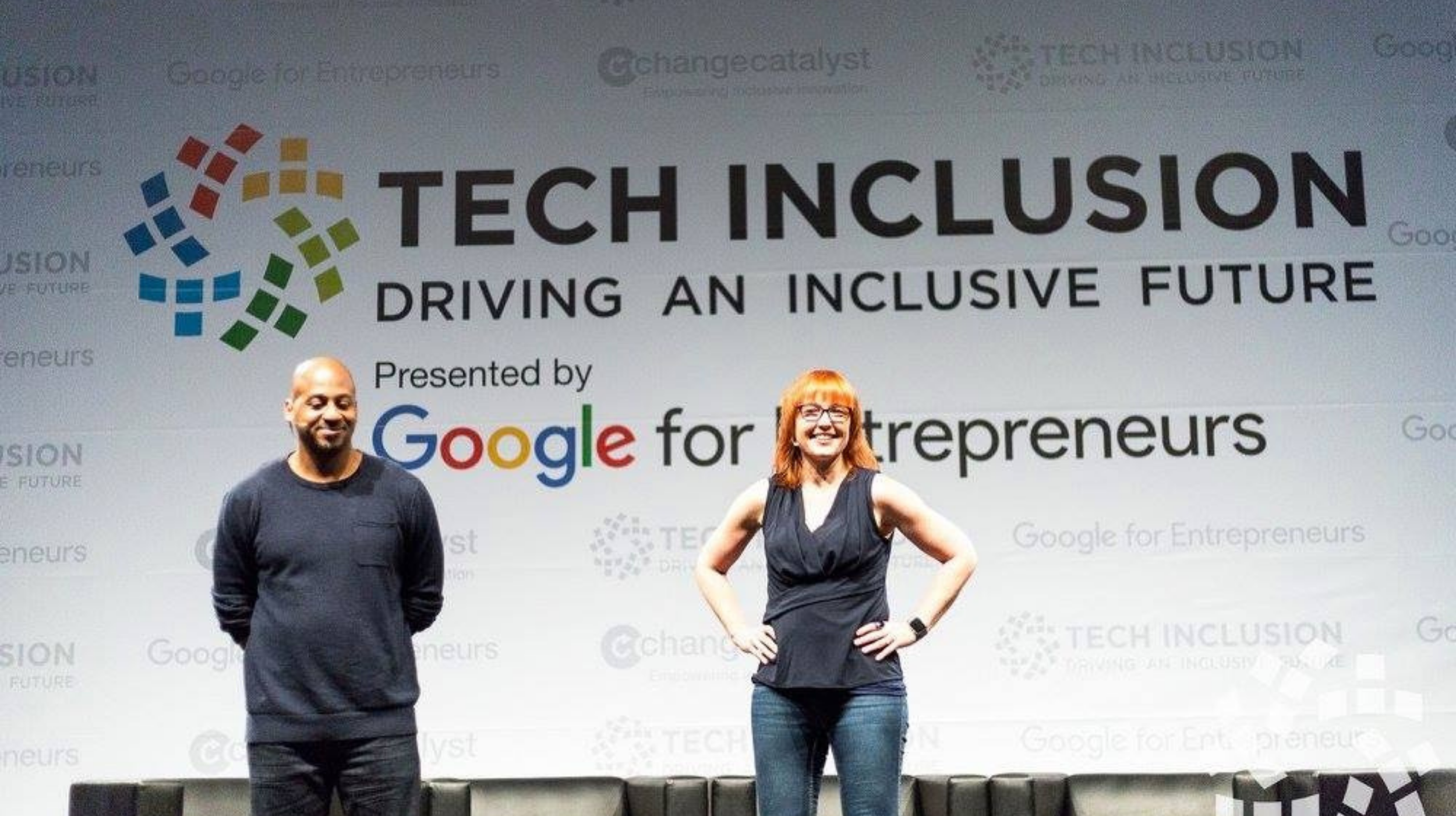 women in tech (image: tech inclusion panel with man and woman on stage)