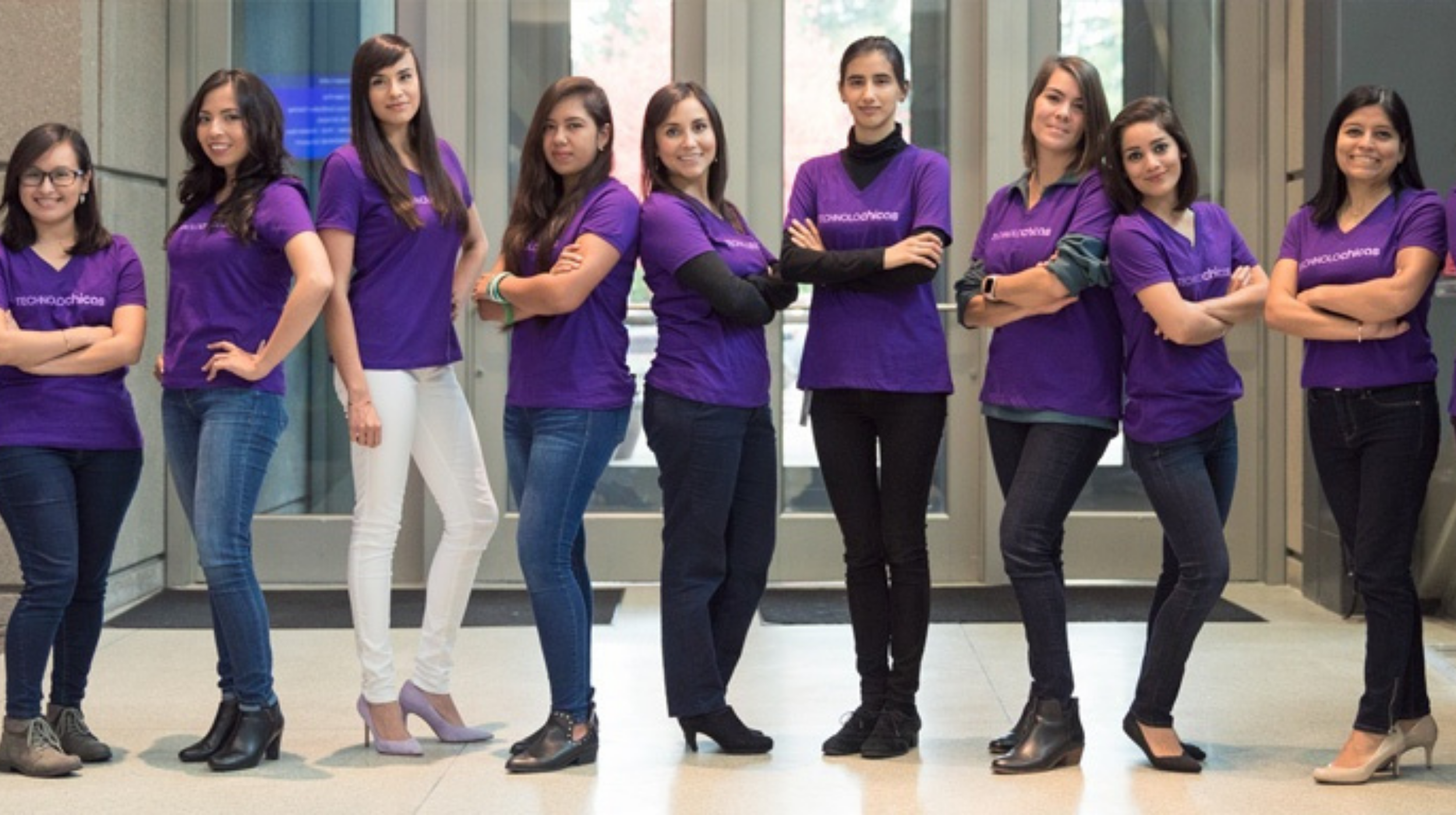 women in tech (group of young women in purple shirts post for photo)