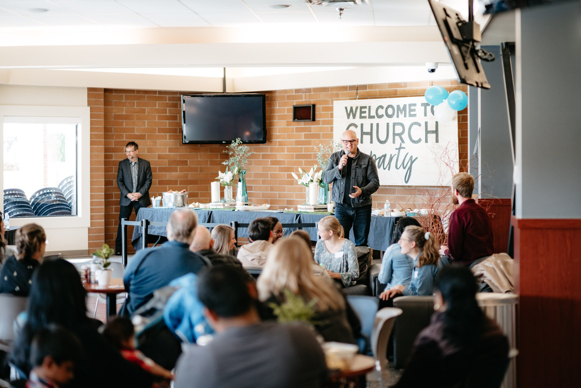A photo of a welcome to church party