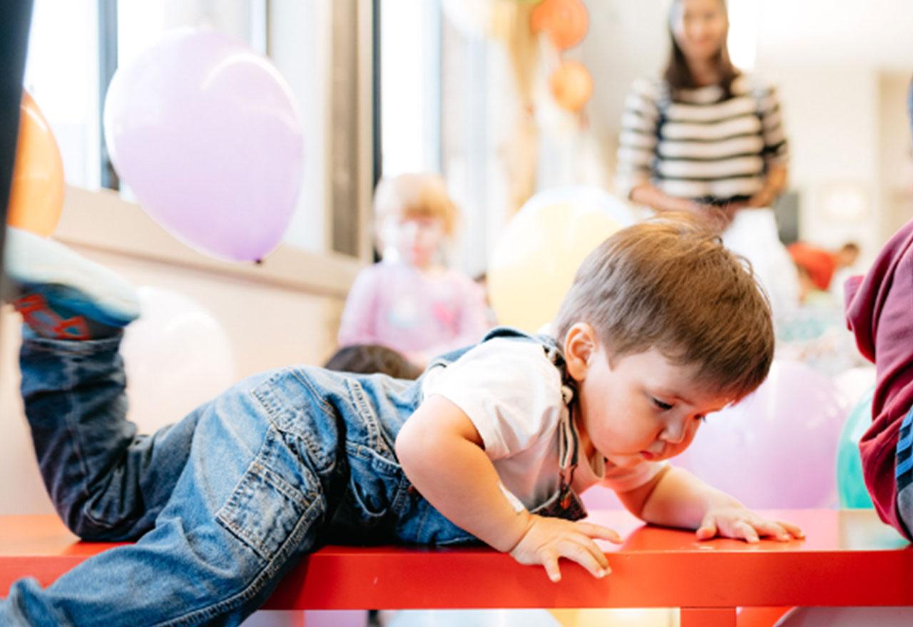 A CLA kids nursery child playing.