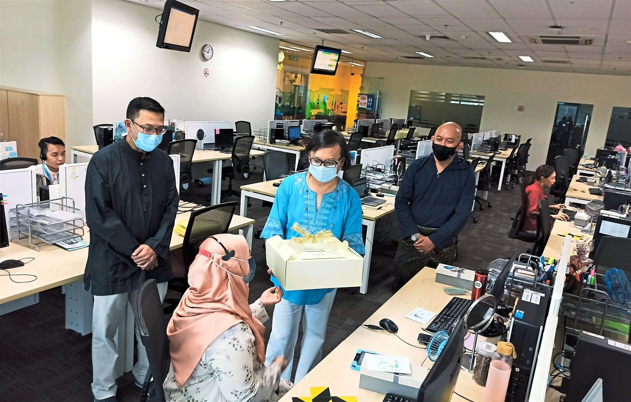 Companies bring cheer to their staff on duty during Raya