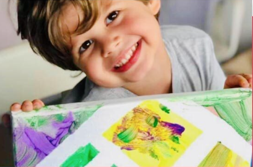 Kid Smiling and painting