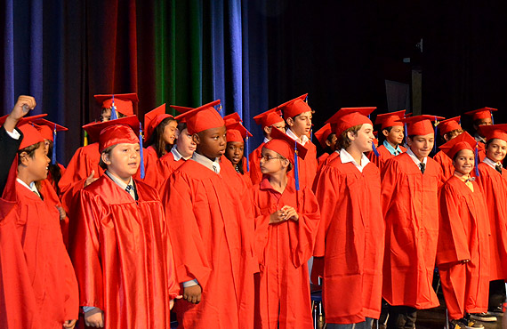 Students wearing graduation gown