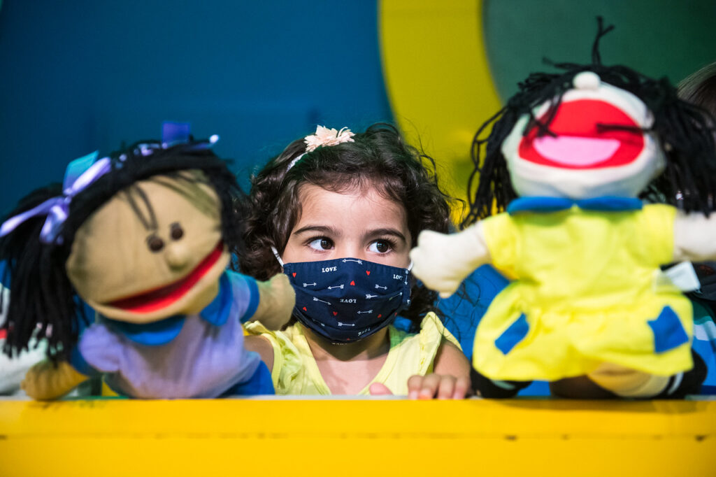 Kid with puppets
