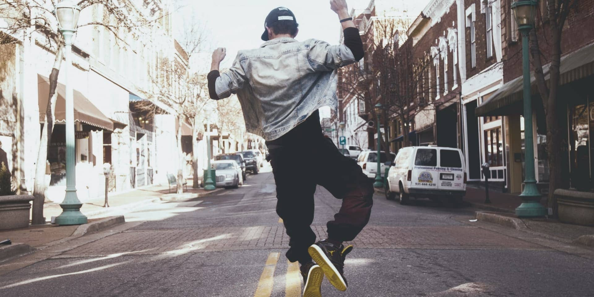 Man Jumping In the Street, by Andre Hunter from Unsplash