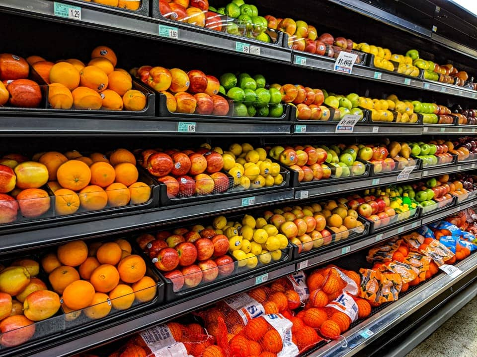 Fruit display in a supermarket by Gemma from Unsplash