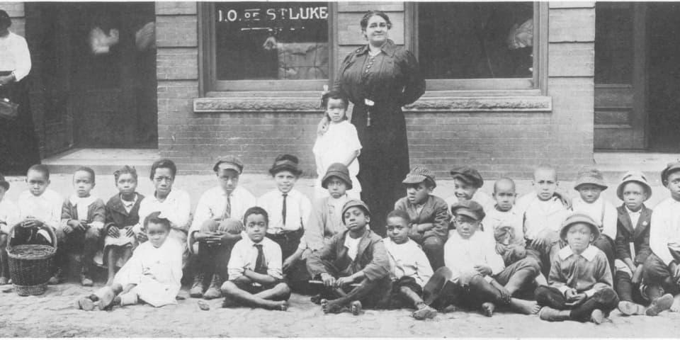 Walker with local children in Richmond, VA.