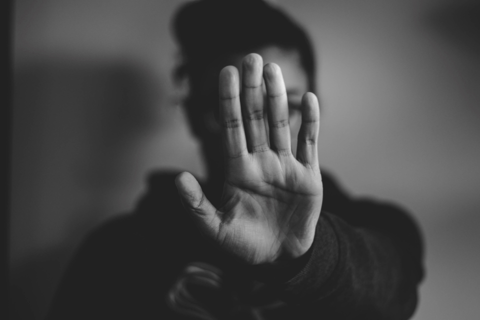 Person holding up a hand as if to say 'stop', by Nadine Shaabana from Unsplash.com