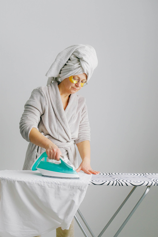 women ironing a shirt