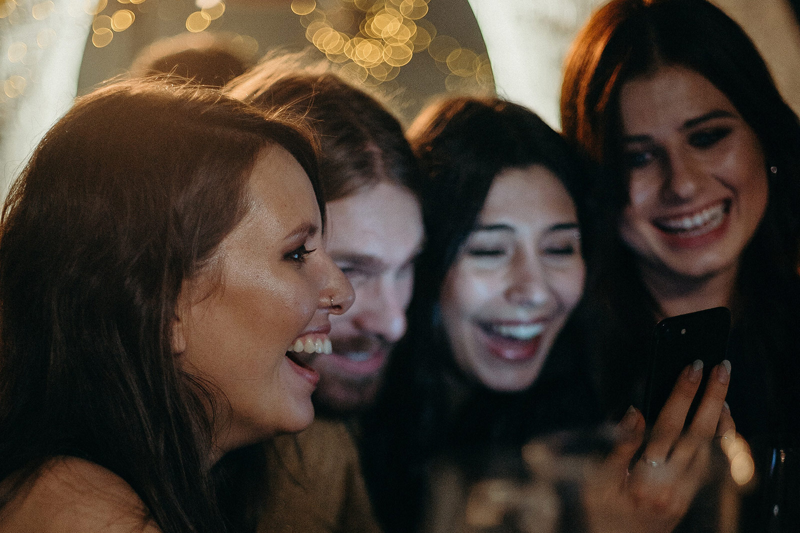 women laughing at a bar