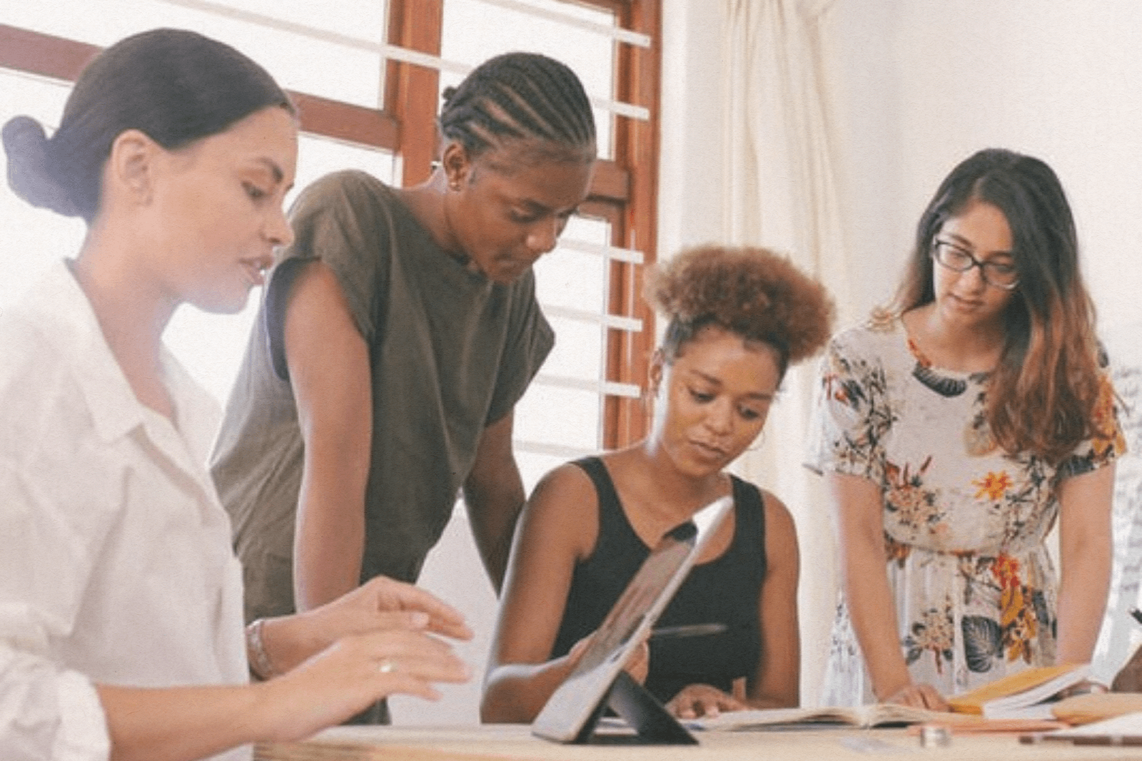 group of young women in a planning meeting