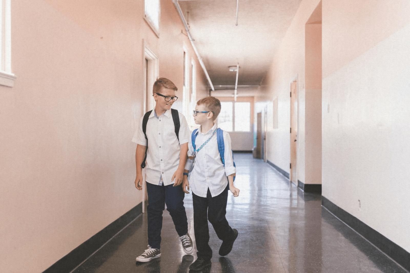 two young boys in school hallway