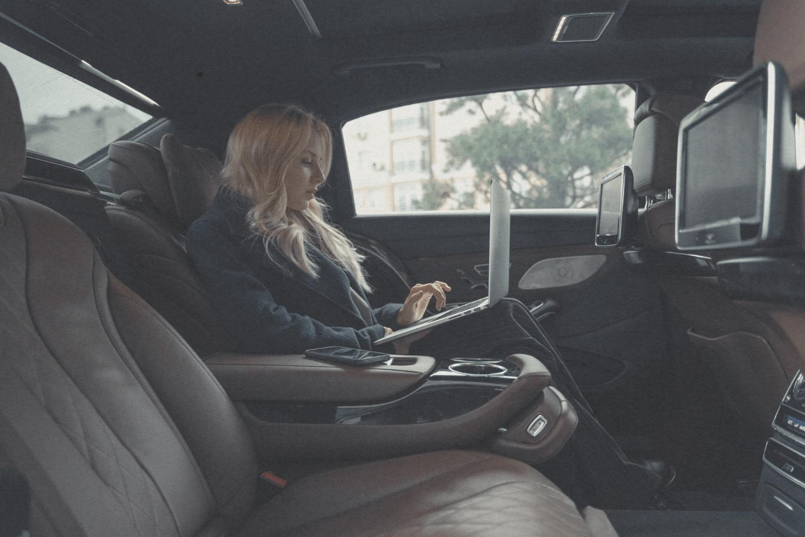Women in car on laptop
