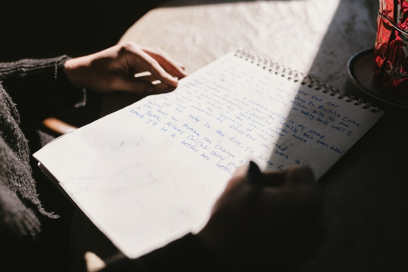 writing notes in a journal