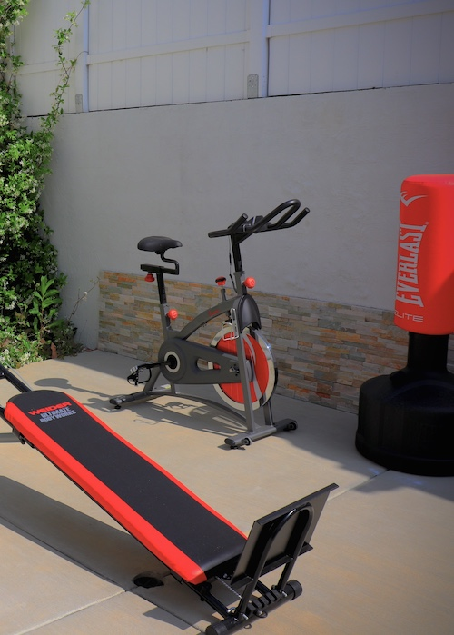 Shot of the outdoor gym area at hhr where there is red equipment.