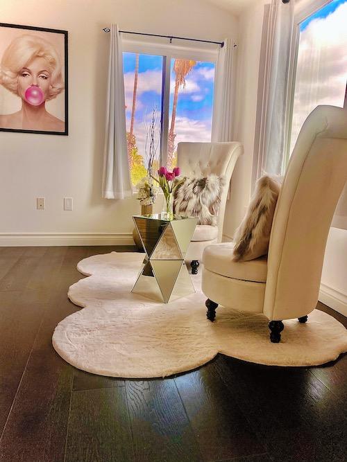 A shot of a reading nook inside the hhr house, a picture of Marilyn Monroe hangs on the wall.