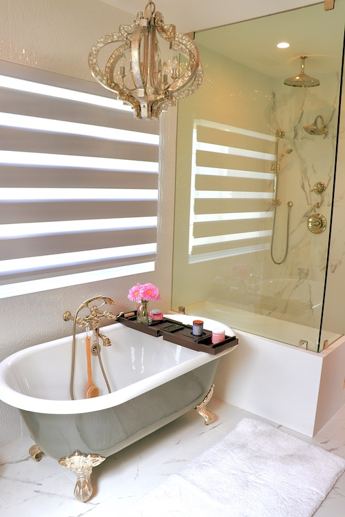 A shot inside one of the bathrooms at hhr with elegant features and a vintage tub.