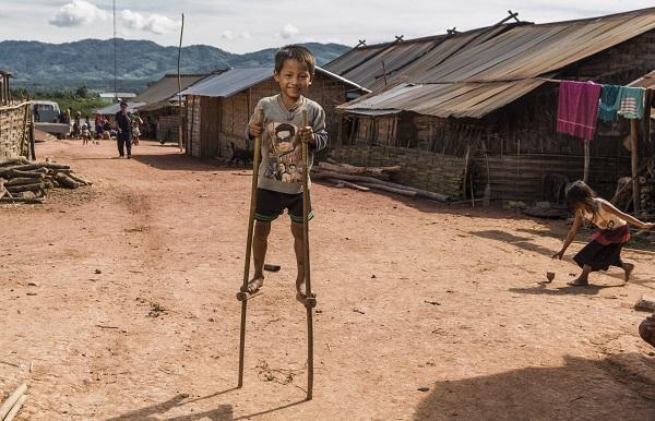 Local Child On Stilts