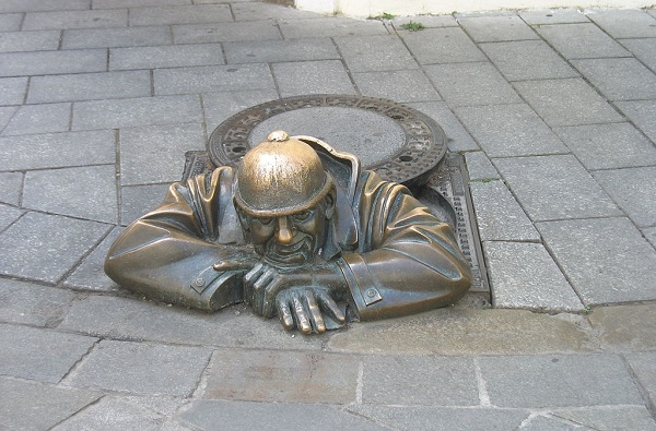 Cumil Man At Work Sculpture