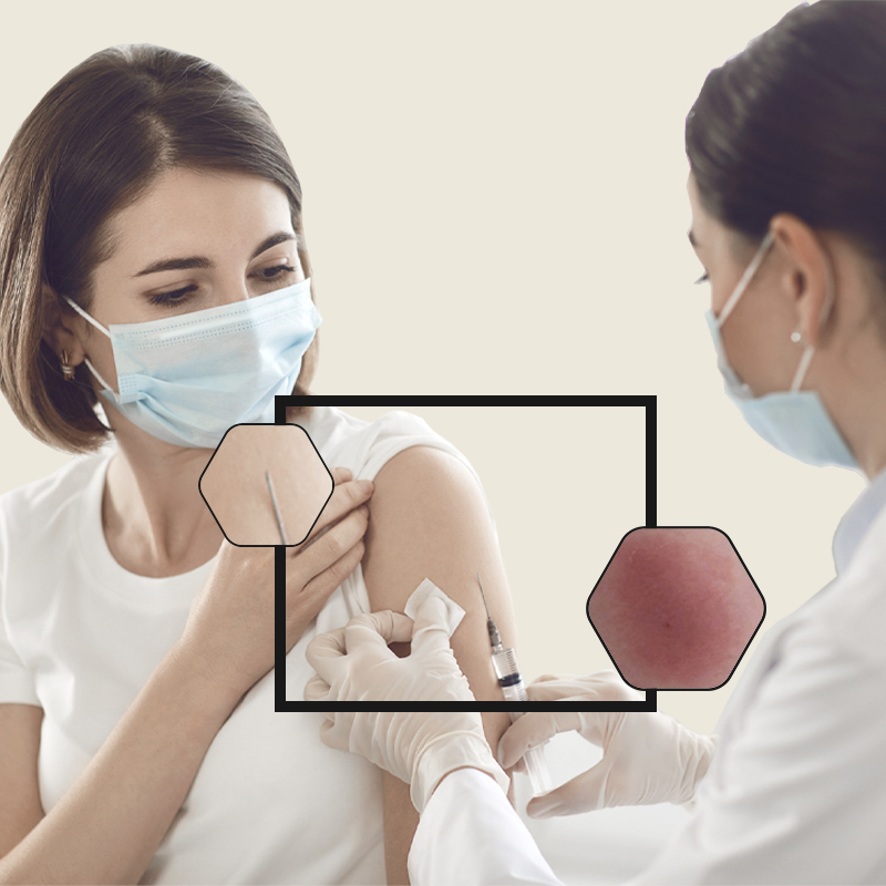 Female professional with mask administering vaccination into the arm of a female patient with mask