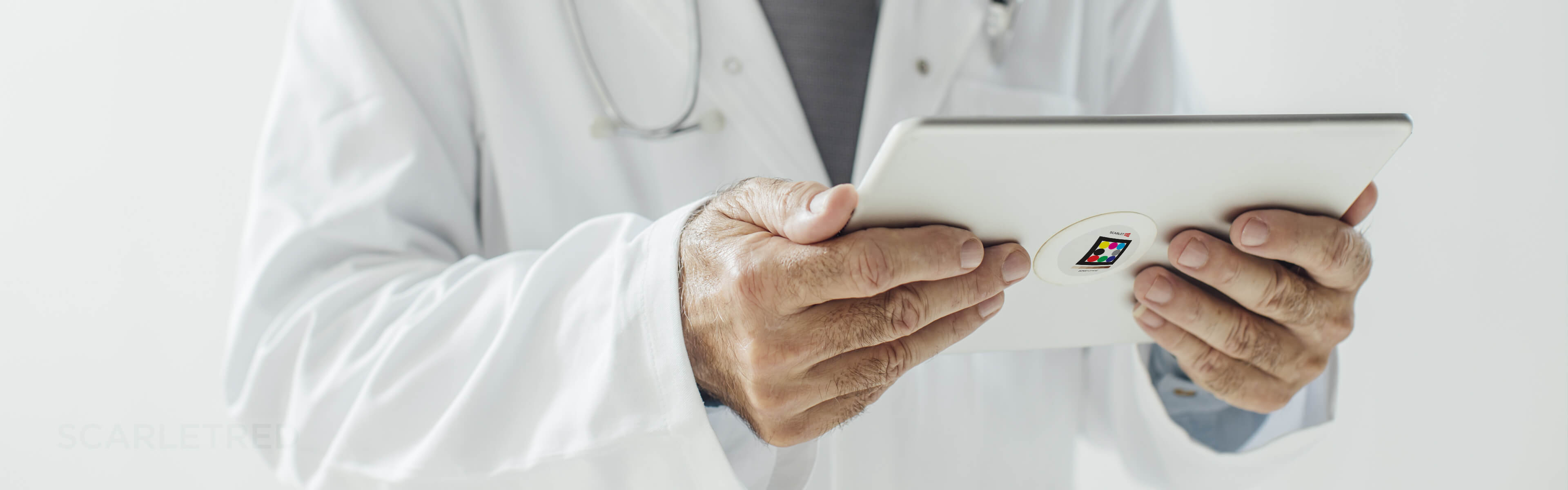 Doctor is remotely monitoring clinical trials on the Scarletred platform